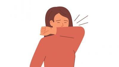 Illustration einer Frau, die in die Armbeuge hustet. (Getty Images / Ponomariova Maria)