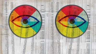 Illustration von zwei Augen die einen anschauen, mit einem Farbkranz um die Pupillen. Auf Zeitungspapier mit vielen Zahlen. (imago images / Roy Scott)