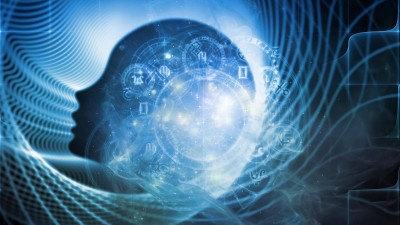 Symbolbild für Gehirn und Spiritualität - ein menschlicher Kopf in blauem Nebel, darüber zeichnen sich unter anderem die Symbole des Tierkreises ab (imago stock&people / agsandrew)