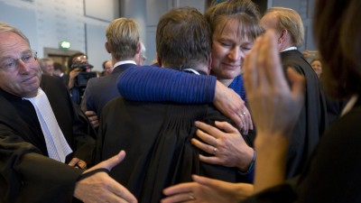 Urgenda director Marjan Minnesma, center right, hugs members of her legal team after the court turned down an appeal of the Dutch government against a 2015 landmark ruling ordering the government to cut the country's greenhouse gas emissions by at least 25 percent by 2020 in a climate case that activists hope will set a worldwide precedent, in The Hague, Netherlands, Tuesday, Oct. 9, 2018. The case was brought to court by Urgenda, a sustainability organization on behalf of some 900 citizens, claiming that the the government has a duty of care to protect its citizens against looming dangers.(AP Photo/Peter Dejong) | (AP)